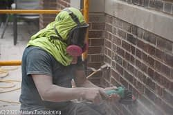 Removing old mortar.